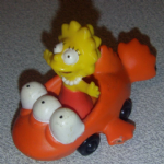 The Simpsons Lisa Simpson in mutated fish toy car